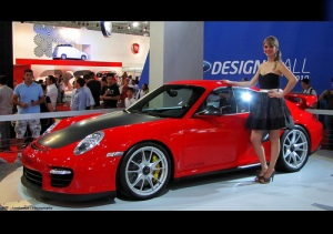 2011 Red Porsche GT2 RS and girl