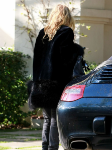 Mary Kate Olsen and black Porsche 911 Carrera
